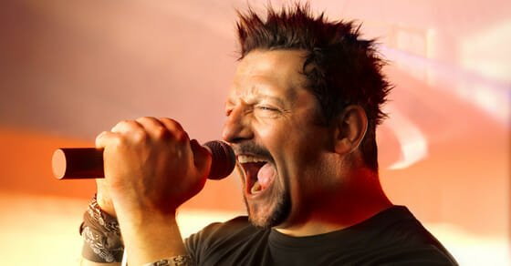 male singer who appears to be yelling into the microphone