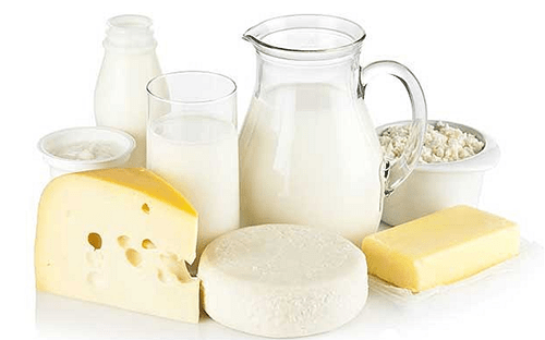 Bottles of milk and wheels of cheese