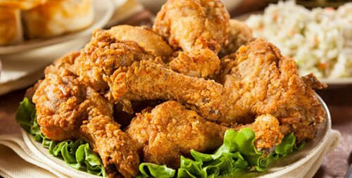 Fried chicken on a plate with lettuce