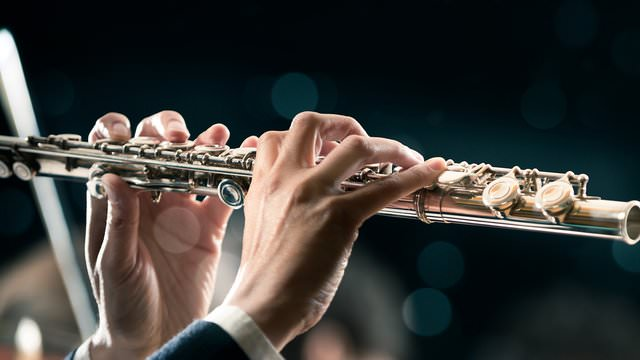 hands playing a clarinet