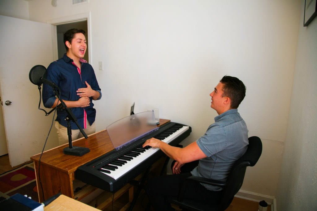 voice teacher at piano