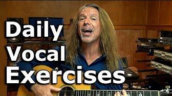 man playing guitar and singing