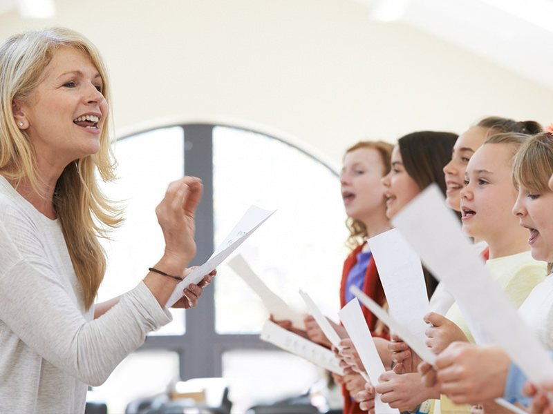 singing coach leading choral students
