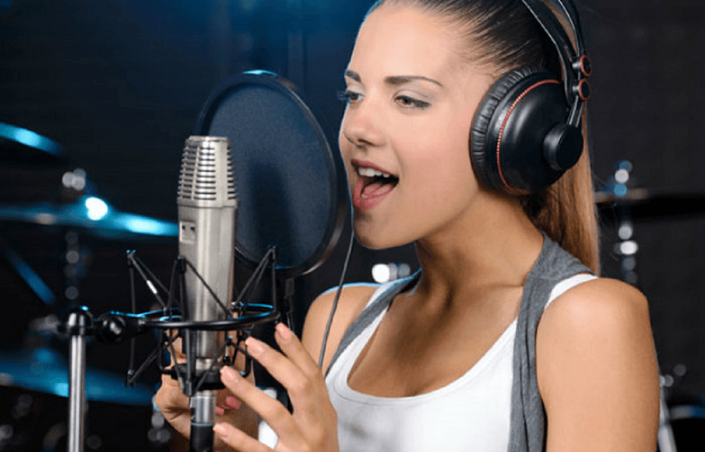 girl standing in front of studio microphone